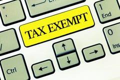 Het conceptuele hand het schrijven Van belastingen vrijgesteld tonen Het Inkomen of de transacties van de bedrijfsfototekst dat v royalty-vrije stock afbeeldingen