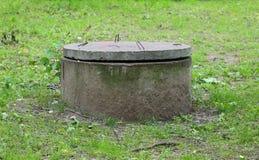 Het concrete mangat stock foto's
