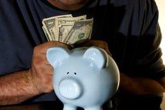 Het contante geld van het spaarvarken stock foto