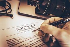 Het Contract van de fotografiediensten stock foto