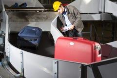 Het controleren van bagage Royalty-vrije Stock Foto