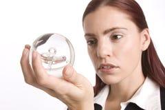 Het controleren van haar kristallen bol stock afbeeldingen