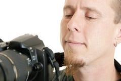Het controleren van zijn werk Stock Foto's