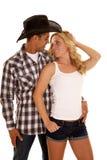 Het cowboypaar bekijkt elkaar royalty-vrije stock foto