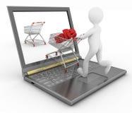 het 3d mens en laptop online winkelen Stock Foto's