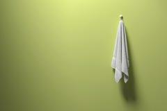 het 3D teruggeven: illustratie van een stuk van het schone en witte handdoek hangen op een groene pastelkleurmuur, een licht en e Stock Afbeelding