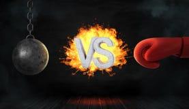 het 3d teruggeven van concrete brieven VERSUS gevangen op brand tussen een slopende bal en een rode bokshandschoen Stock Foto's