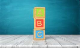 het 3d teruggeven van een stuk speelgoed drie blokkeert status op een houten bureau in één toren met brieven A, B en C op hen Stock Fotografie
