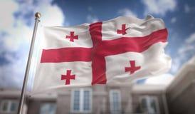 Het 3D Teruggeven van Georgia Flag Flag op Blauwe Hemel de Bouwachtergrond Stock Afbeeldingen