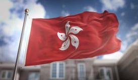 Het 3D Teruggeven van Hong Kong Flag op Blauwe Hemel de Bouwachtergrond Stock Foto