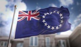 Het 3D Teruggeven van kokislands flag op Blauwe Hemel de Bouwachtergrond Stock Afbeeldingen