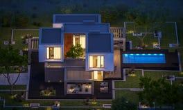 het 3d teruggeven van modern huis in de tuin bij nacht Stock Afbeelding