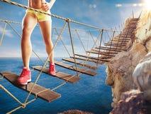 het 3D Teruggeven van reis op een afbrokkelende brug Stock Foto