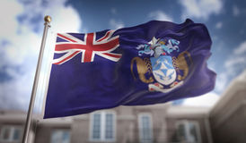 Het 3D Teruggeven van Tristan da Cunha Flag op Blauwe Hemel die Backgrou bouwen Stock Afbeelding