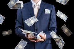 Het dalende Japanse geld van zakenmanvangsten Stock Afbeeldingen