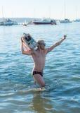 Het dansen in de oceaan in het nieuwe jaar Stock Afbeelding