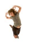 Het dansen meisje het springen Stock Afbeeldingen
