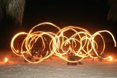 Het dansen met brand Stock Foto's