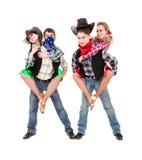 Het de dansersteam van het cabaret kleedde zich in cowboykostuums Stock Foto