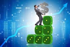 Het de dollarteken van de zakenmanholding bovenop dobbelt piramide Stock Afbeelding