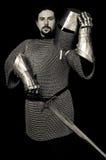 Het de middeleeuwse Helm en zwaard van de Ridderholding royalty-vrije stock foto's