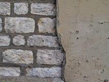Het de muurpatroon van de baksteen en van het pleister, sluit omhoog. Royalty-vrije Stock Foto's