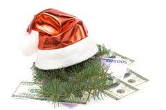 Het de rode hoed en geld van de kerstman Royalty-vrije Stock Afbeelding