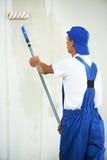 Het de vernieuwingswerk van de schilder thuis met eerste Royalty-vrije Stock Afbeeldingen