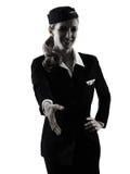 Het de vrouwenhandenschudden van het stewardesscabinepersoneel isoleerde silhouet Stock Foto