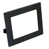Het decoratieve zwarte kader van de leerfoto dat op witte backgroun wordt geïsoleerd Stock Foto