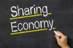 Het delen van Economie Stock Foto's