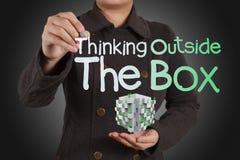 Het denken buiten de doos als concept Stock Fotografie