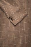Het detail van bemant bruine jasjetextuur royalty-vrije stock afbeelding