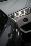 Het detail van de autokoplamp Stock Afbeeldingen