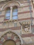 Het detail van de hoek van oud bicolored het inbouwen van de stad van Neptunus in Italië royalty-vrije stock afbeeldingen