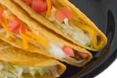 Het detail van de taco op zwarte plaat Stock Afbeelding