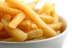 Het detail van frieten dat op wit wordt geïsoleerd= Stock Afbeeldingen