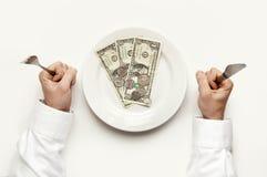 Eet geld. Stock Foto