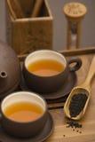 Het dienen van de thee Stock Afbeelding