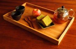 Het Dienen van de thee Royalty-vrije Stock Afbeeldingen