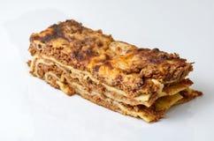 Het dienen van lasagna's Stock Afbeeldingen