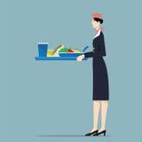 Het dienende voedsel van de luchtvaartlijnstewardess Royalty-vrije Stock Foto