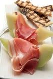 Het diner van de ham en van de meloen royalty-vrije stock afbeeldingen