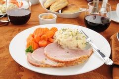 Het diner van de ham met wijn stock foto
