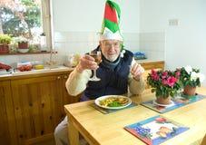 Het dineren alleen bij Kerstmis. Royalty-vrije Stock Afbeeldingen