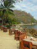 Het dineren op het strand Stock Foto's