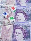 Het dobbelen met de munt: Pond Sterling. Stock Afbeeldingen