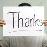 Het document van de handholding schrijft dankwoord Stock Fotografie