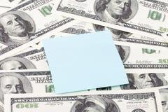 Het document van de nota op dollarsachtergrond Stock Foto's