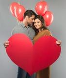 Het document van de paarholding hart Stock Foto